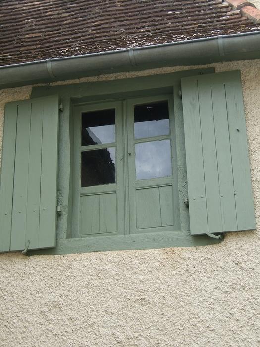 Une fenêtre mixte vitre et bois